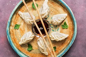 Asian dumplings with soy sauce