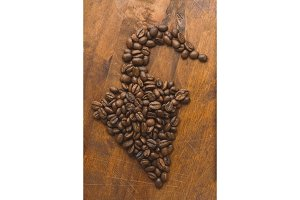 Brown coffee beans in shape of