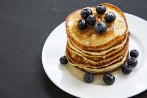Pancakes with blueberries and honey