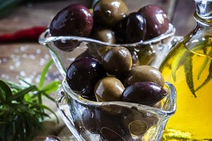 Black and green Greek olives in glas