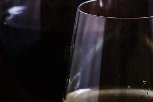 Red and white wine in glasses, dark