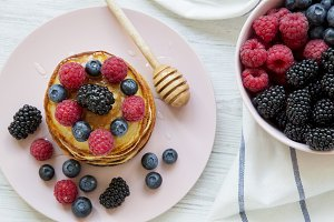 Top view, pancakes with berries