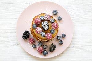 Pancakes with berries, sugar