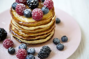 Pancakes with berries, side view.