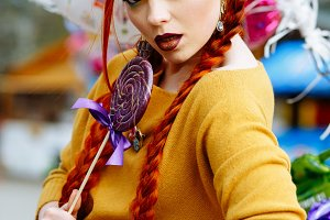 red-haired girl with purple candy