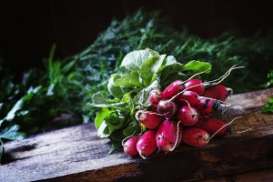 Dirty radish, vintage wooden backgro