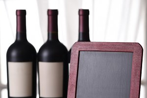 Three bottles of red wine and blank
