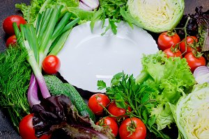 Raw vegetables for salad around plat
