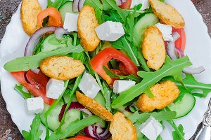 salad with arugula, cheese, tomatoes