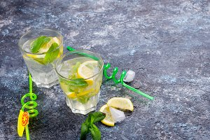 Glass of a cold mojito, juicy slised