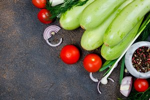 Young spring zucchini, tomatoes, her