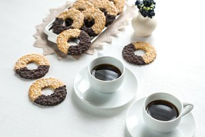Chocolate cookies and cups of coffee