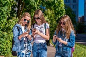 Three girls schoolgirl. Summer in
