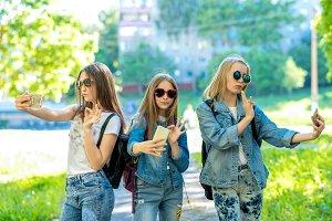Three teenage girls. In denim