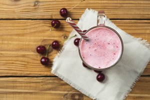 Cherry smoothie on wooden rustic tab
