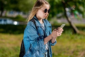 A teenage girl in summer denim
