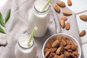 Almond milk on a white wooden table