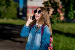 Girl schoolgirl talking smartphone