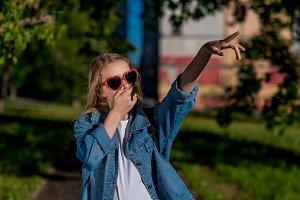 Girl schoolgirl. Summer in nature