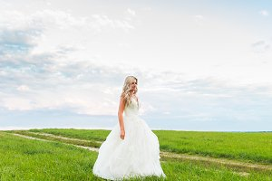Young blonde woman bride spinning ou