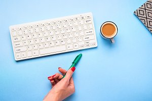 Keyboard, coffee and pen. Writing co