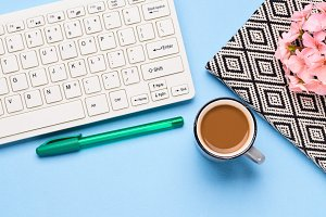 Keyboard, notebook, pen, coffee. Wri