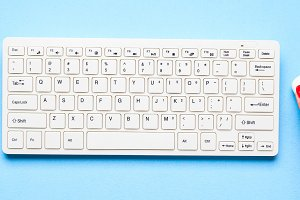 White keyboard and woman's hand on m