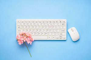 White Keyboard with flowers. Writing