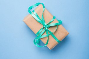 Wrapped gift with ribbon on blue
