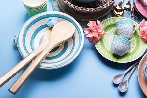 Tableware dish set on blue pastel ba