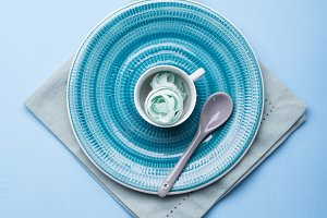 Blue ceramic dish on napkin with flo