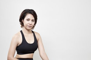 Asians woman exercise on fitness bal