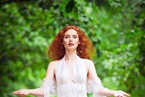 Beautiful redhead woman in dress