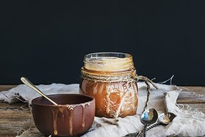 Salted caramel sauce in a glass jar