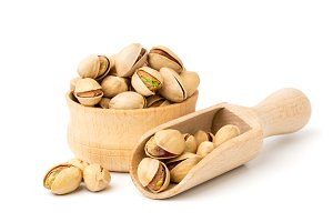Pistachio nuts in a wooden plate