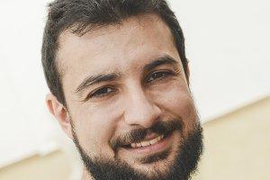 Smiling bearded 30s man