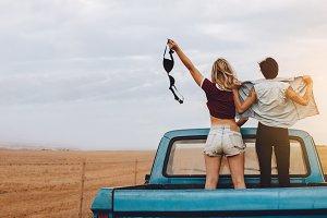Women having fun traveling by pickup
