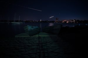 Long exposure lake with meteor