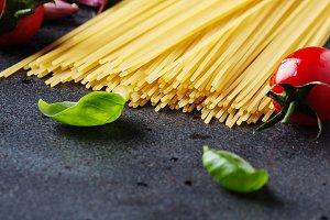 Uncooked spaghetti with tomato