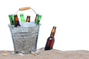 Assorted beer bottles in a bucket of