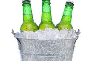 Green beer bottles in a bucket of ic