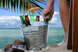 Man With Beer Bucket at the Beach