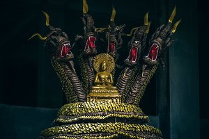Golden Buddhist Statue with Dragons