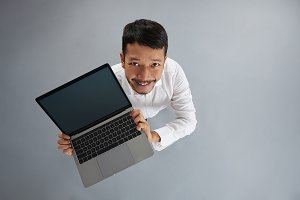 Young asian man with laptop