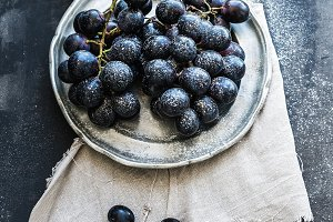 Bunch of fresh grapes in metal plate