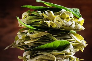 Dry spinach pasta with green leaves,