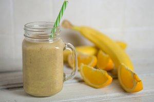 Fresh banana and orange smoothie on