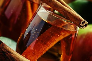 Apple juice with cinnamon in a glass