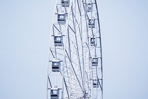 Modern ferris wheel on blue sky back