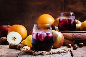 Red wine with fruit and ice on a dar